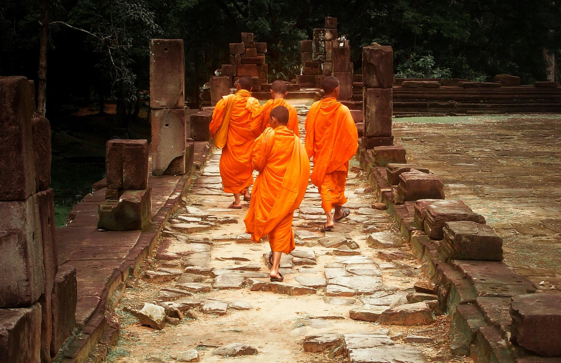 Buddhist monks inside Baphuon temple